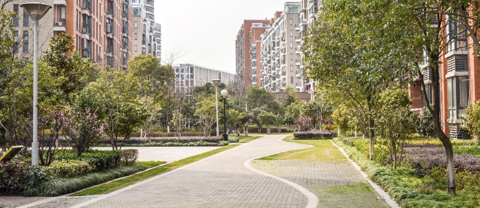 view of landscape outside apartment complex