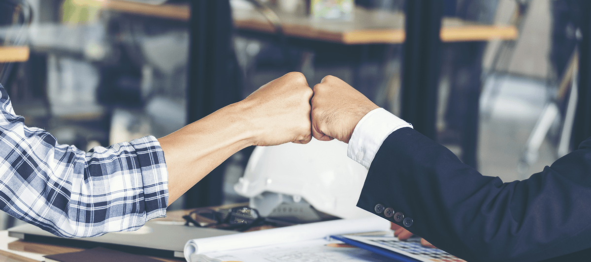 two business partners bumping hands