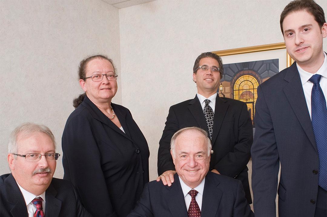 Dickler, Kahn, Slowikowski & Zavell smiling for portrait