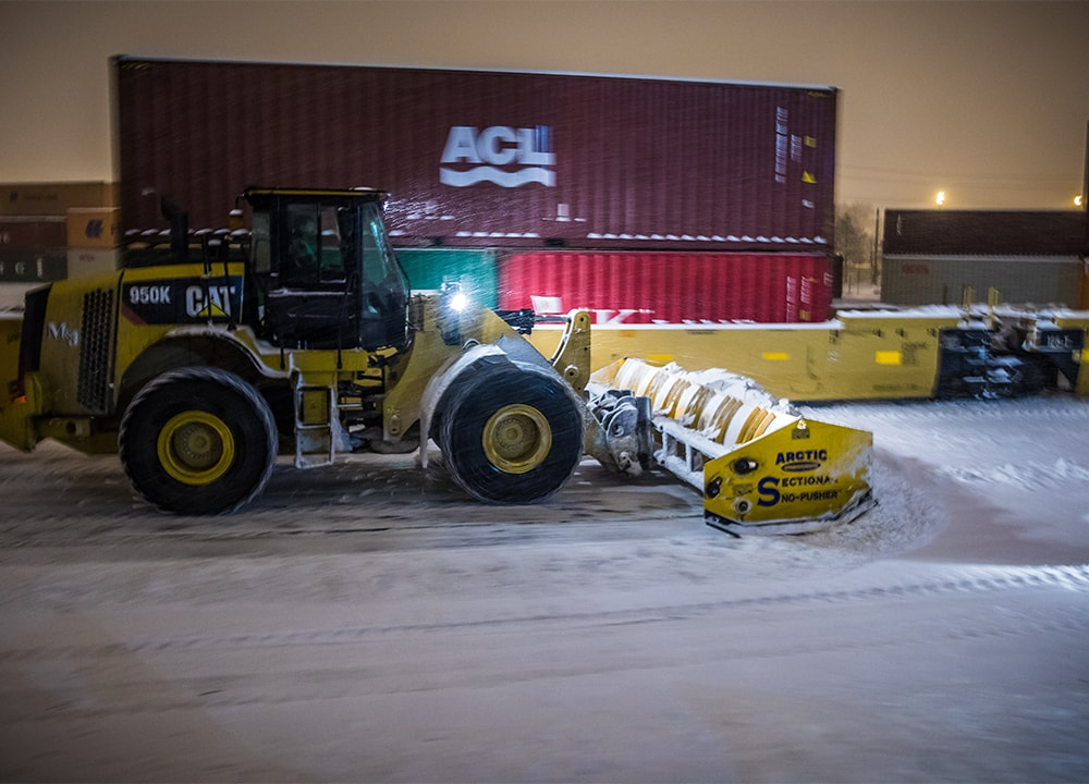 M&J Asphalt Paving Company removing snow at a warehouse