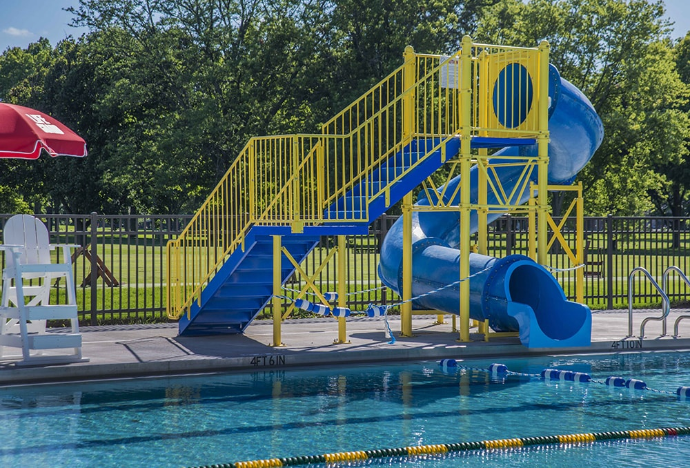 blue and yellow water pool slide