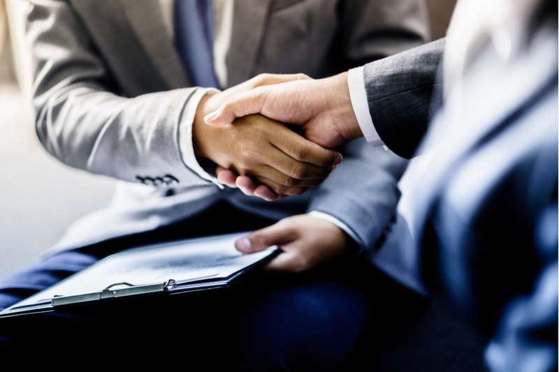 two gentleman shaking hands