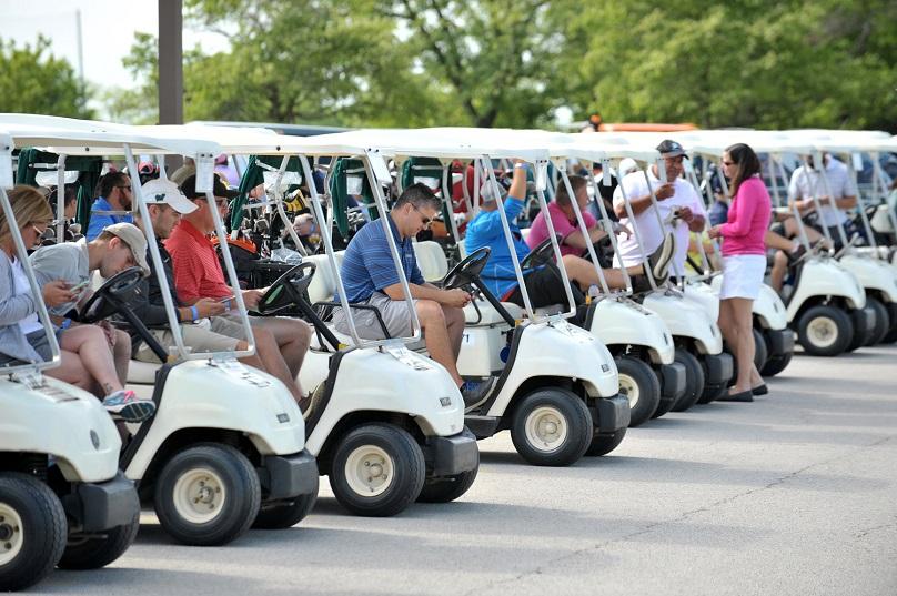 golfers sitting in their golf carts