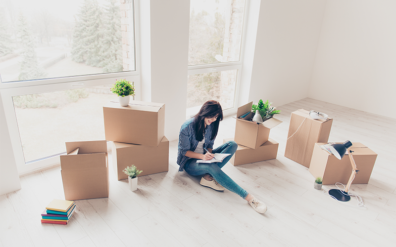 woman completing the condominium unit buyer's check list
