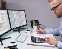 man using computer for financial management