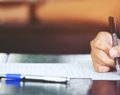 woman filling out paperwork after assessment
