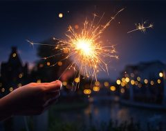 sparkler and fireworks are used in a neighborhood
