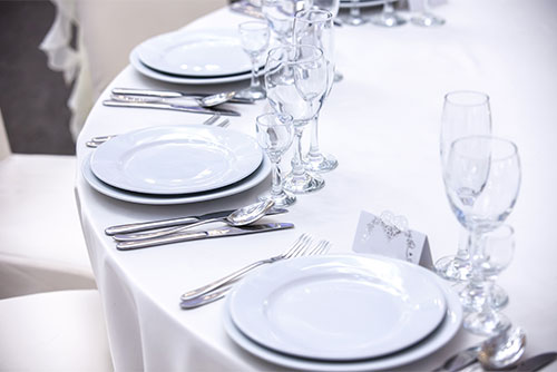 dinner plates in banquet hall
