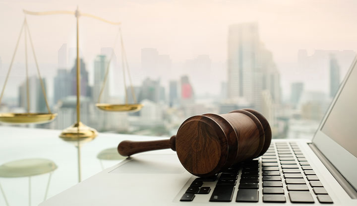 laptop with gavel on top
