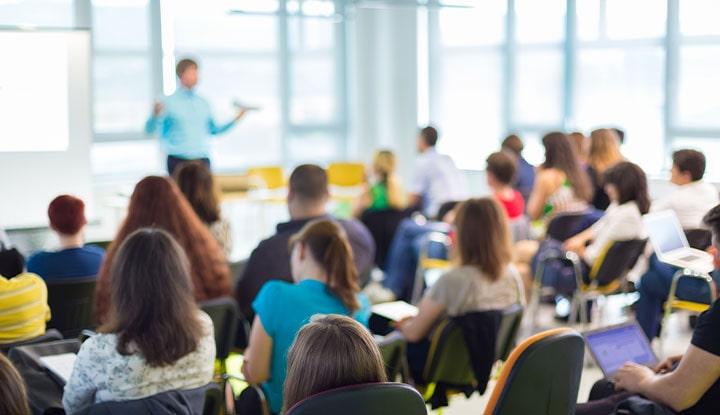 community association manager leading education session