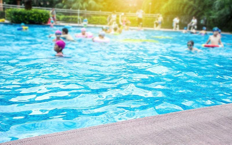 kids swimming in community association pool