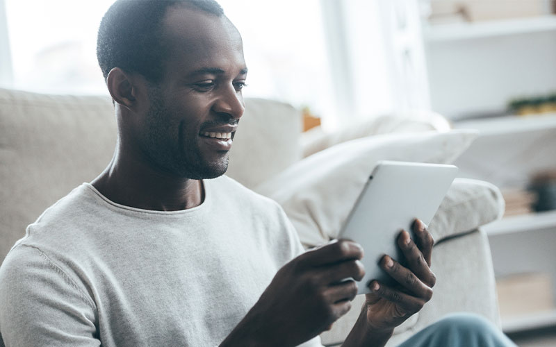 man using tablet to video chat