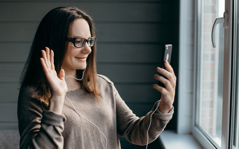 woman using video call feature on phone