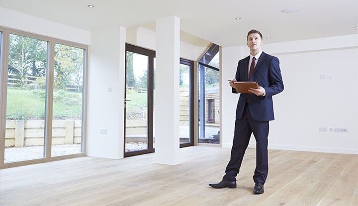 real estate professional conducting townhome appraisal