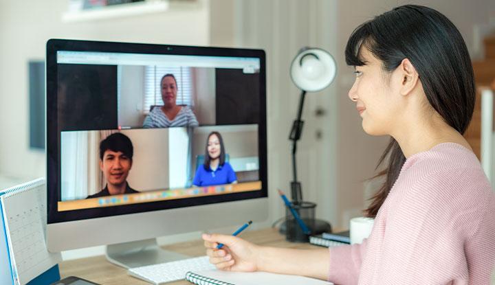 woman speaking to coworkers in virtual meeting