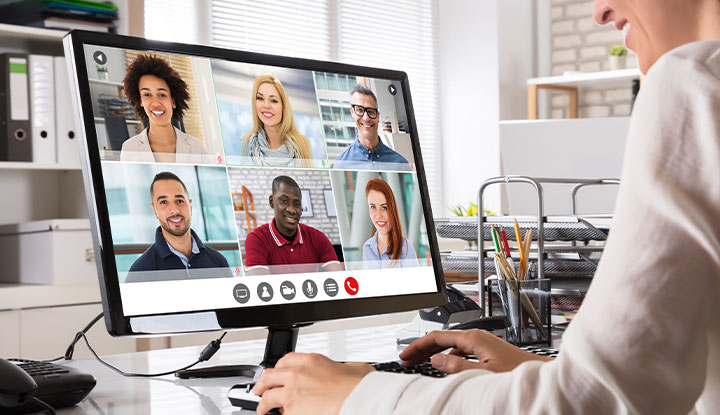 community association manager on virtual call with other staff