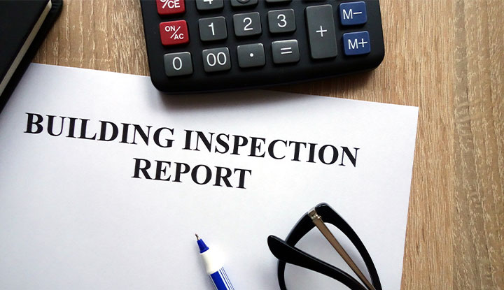 building inspection report on community association manager's desk