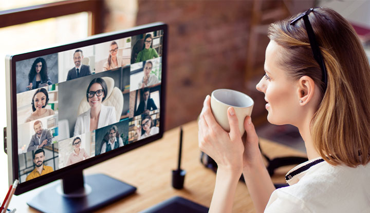 woman participating in virtual conference and expo for community association managers