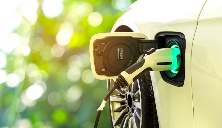 electric car fueling up in a community association