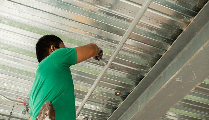 maintenance worker fixing interior of condo building